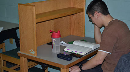 Man studying in a carrel